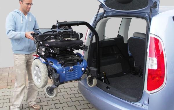 Механический и электрический кран для погрузки коляски